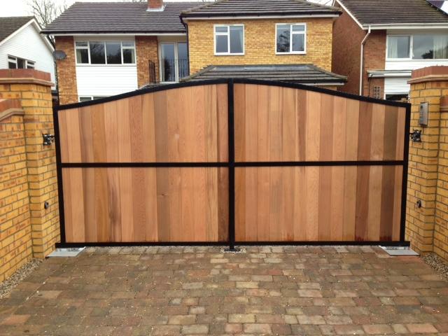 Metal framed wood clad gates